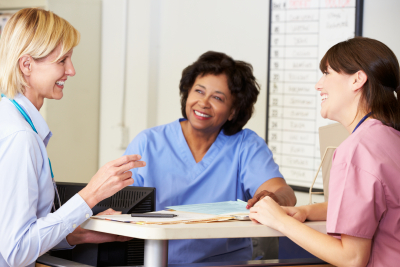 nurses and caregivers talking each other